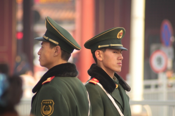 Soldiers keep a watchful eye in Tienanmen Square.