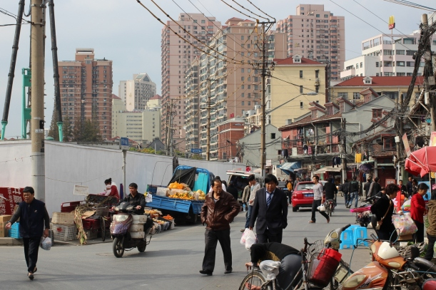 A Shanghai street scene with plenty of vendors and tuk-tuks, note the McDonalds top right - a saviour after months of noodles!
